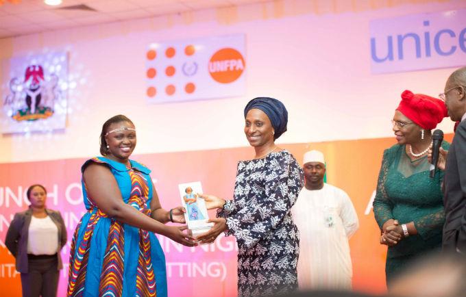 Wife of the Vice President, H.E Mrs. Dolapo Osinbajo presenting the Efua award to the Winner Diana Kendi Makala